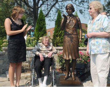 Surviving workers Toots Miller and June Menne preside over the unveiling of the Radium Girls statue in Ottawa, Illinois.