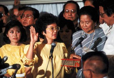 Photo: Corazon Aquino swears in as President of the Philippines at Club Filipino, San Juan on February 25, 1986.