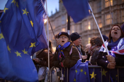 Anti-Brexit protesters demonstrate outside the Houses of Parliament on March 13, 2019 in London