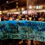 """Anti-Nazi rally in Berlin-Neukölln. The banner says, """"Each of our tears is a sign of our rage and water for the flower of solidarity."""""""