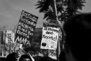 """Bolsonaro, your machista, homophobic, racist discourse kills,"" reads a sign protesting Jair Bolsonaro"