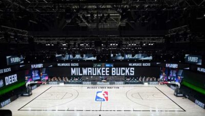 The court and benches are empty of players and coaches at the scheduled start of an NBA basketball first round playoff game between the Milwaukee Bucks and the Orlando Magic, Wednesday, Aug. 26, 2020, in Lake Buena Vista, Fla.