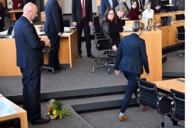 Thueringen Die Linke leader Susanne Henning-Wellsow walking away from AfD-supported and just then newly-elected Thueringen Minister President Thomas Kemmerich after throwing the traditional bouquet at his feet rather than handing it to him, refusing to shake hands with him, and turning her back on him.