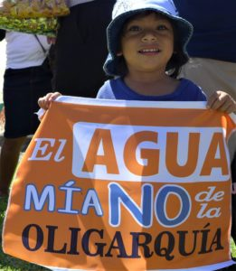 "El Salvador. The sign reads ""The water is mine not the oligarchy's"""