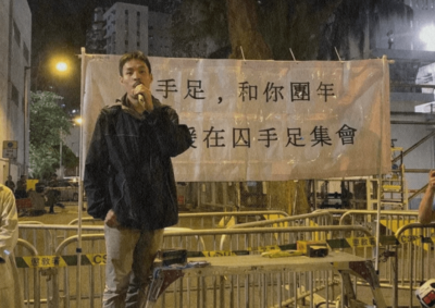 Kuen speaks at a rally with movement comrades.