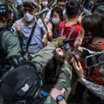 Protesters vs. police in Hong Kong in May.Credit