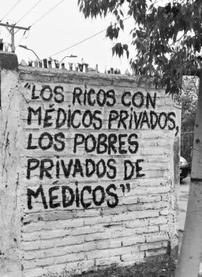 """Street graffiti sums up heath care in most of Latin America: """"The rich have private doctors while the poor are derived of doctors."""""""