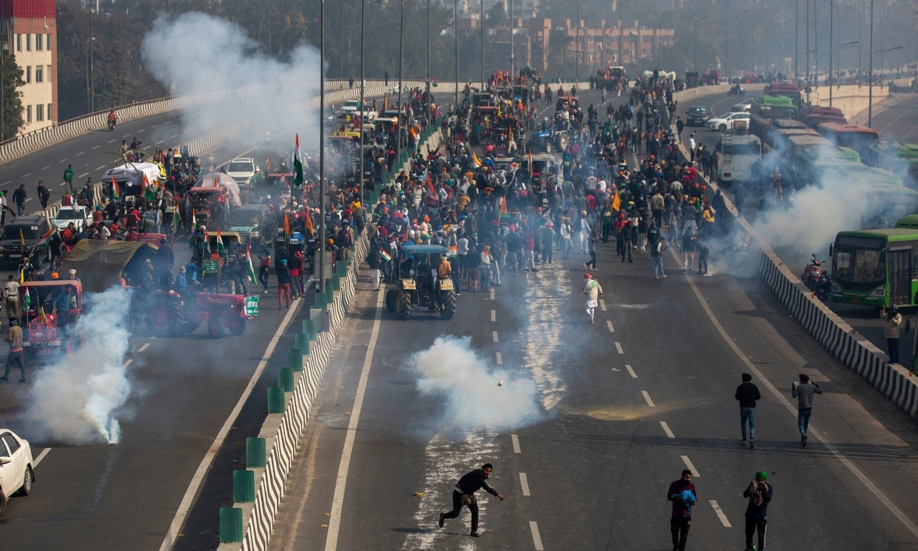 Protesting farmers hurl back tear gas shell as they march to the capital, breaking police barricades, during India's Republic Day celebrations in New Delhi on Jan 26.