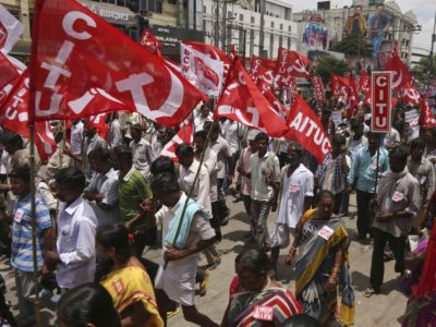 Workers in Hyderabad participate in a rally during a nationwide general strike on September 2, 2016, the largest in human history