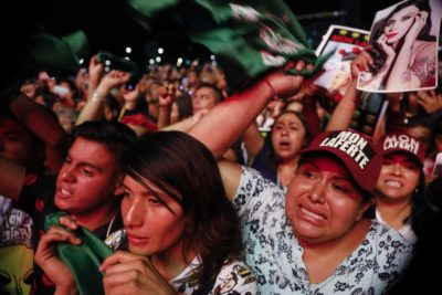 """Mexico City, International Women's Day 2020. Women at a concert by women performers join in the singing of """"Song Without Fear,"""" written to condemn femicide in the country"""