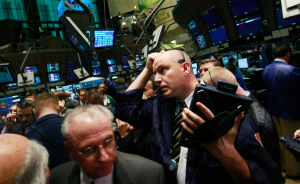 Traders work on the floor moments before the morning bell at the New York Stock Exchange, November 21, 2008