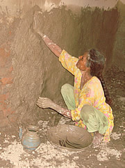 women have taken up repair work with meager resources in Basti Murad Wala-Kot Addu