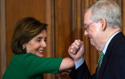 House Speaker Nancy Pelosi, Democrat, and Senate majority leader Mitch McConnell, Republican bump elbows in Washington, March 12, 2020.