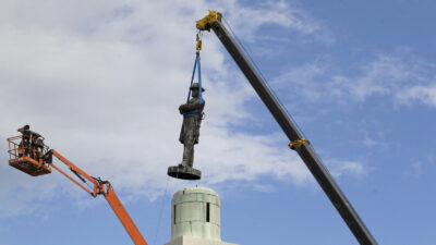 A statue of Confederate Gen. Robert E. Lee being removed from Lee Circle in New Orleans. It was the last of four Confederate statues taken down by a City Council vote that had been proposed by Mayor Mitch Landrieu.
