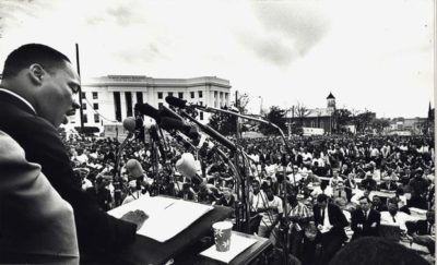 """Martin Luther King, Jr. delivers his """"How Long, Not Long"""" speech on the steps of the Alabama State Capitol in Montgomery, Alabama, March 25, 1965."""