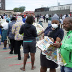 Shoppers queue outside a grocery store during a 21 day nationwide lockdown, aimed at limiting the spread of Covid-19 in Soweto, South Africa, March 30, 2020.